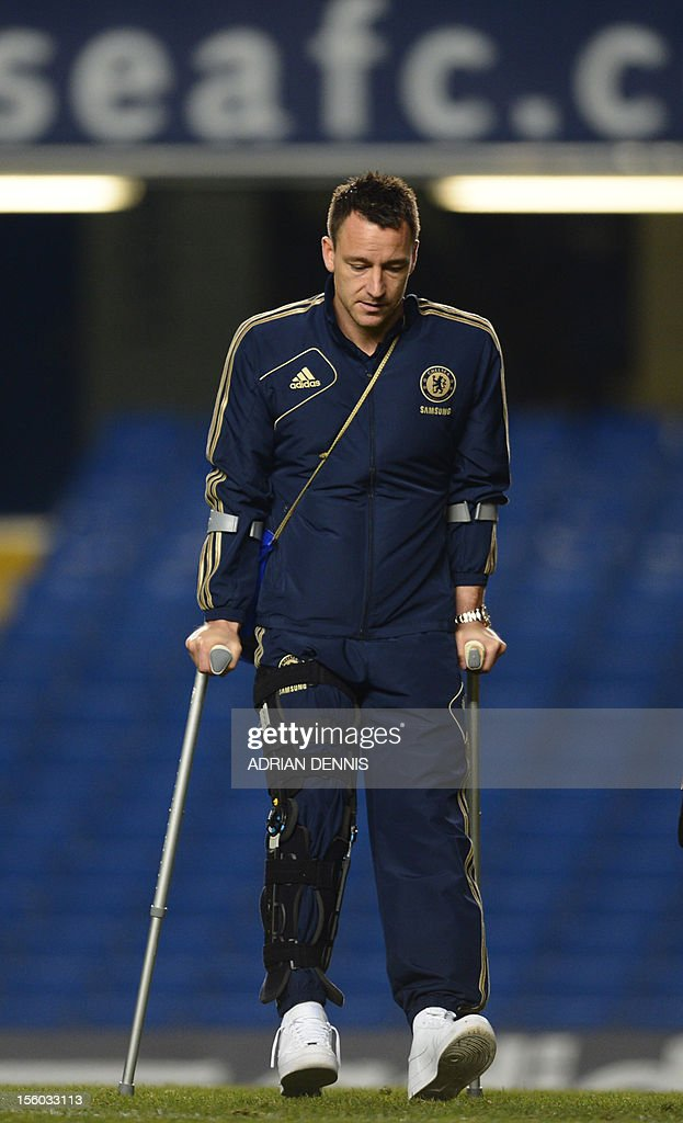 """Chelsea's English defender John Terry is pictured walking on crutches after the English Premier League football match between Chelsea and Liverpool at Stamford Bridge in London, on November 11, 2012. Terry was injured during the match in a collision with Liverpool player Luis Suarez. USE. No use with unauthorized audio, video, data, fixture lists, club/league logos or """"live"""" services. Online in-match use limited to 45 images, no video emulation. No use in betting, games or single club/league/player publications."""