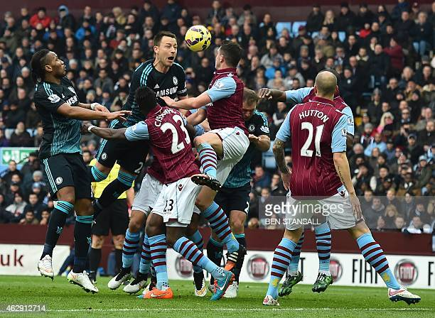 Chelsea's English defender John Terry jumps to win a header during the English Premier League football match between Aston Villa and Chelsea at Villa...