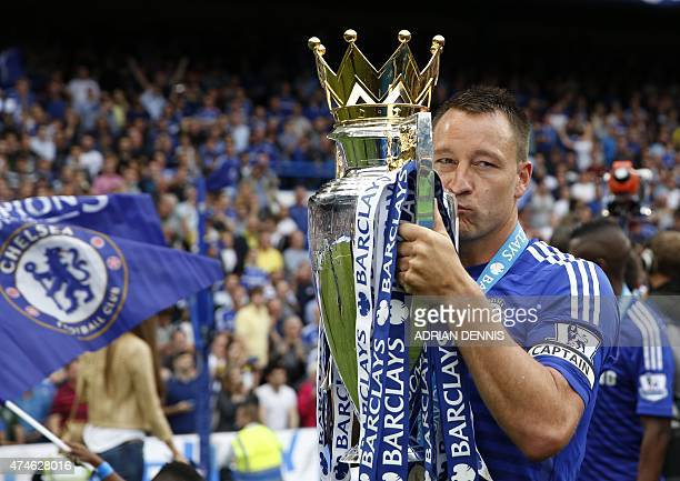 Chelsea's English defender John Terry kisses the Premier League trophy after the English Premier League football match between Chelsea and Sunderland...