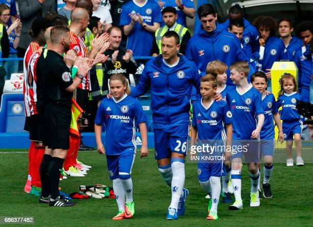 Chelsea's English defender John Terry leads the team out ahead of the English Premier League football match between Chelsea and Sunderland at...