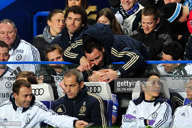 Chelsea's English defender John Terry leans over to congratulate recently substituted English midfielder Frank Lampard after he scores their fourth...