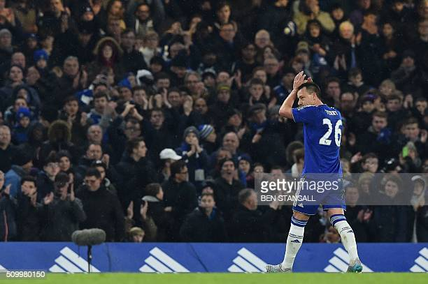 Chelsea's English defender John Terry leave the pitch after being substituted during the English Premier League football match between Chelsea and...