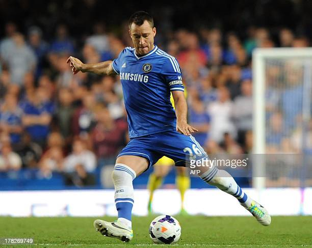 Chelsea's English defender John Terry passes the ball during the English Premier League football match between Chelsea and Aston Villa at Stamford...