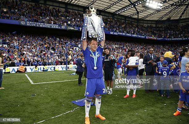 Chelsea's English defender John Terry poses with the Premier League trophy after the English Premier League football match between Chelsea and...