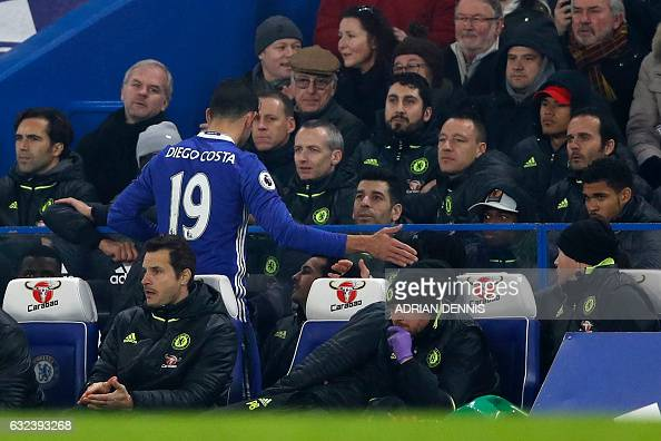 Chelsea's English defender John Terry reacts as Chelsea's Brazilianborn Spanish striker Diego Costa leaves the pitch during the English Premier...