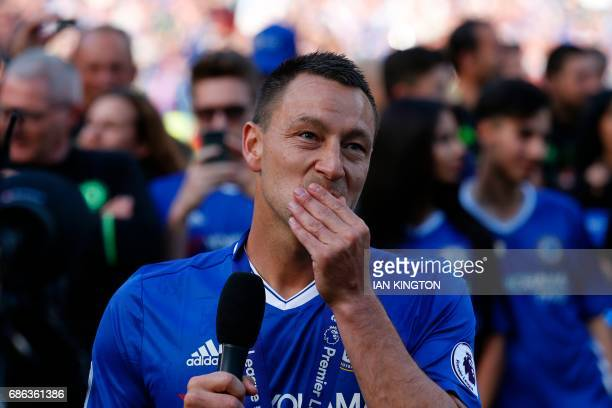 Chelsea's English defender John Terry reacts as players celebrate their league title win on the pitch at the end of the Premier League football match...