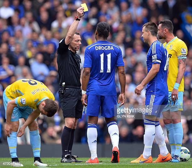 Chelsea's English defender John Terry receives a yellow card during the English Premier League football match between Chelsea and Crystal Palace at...