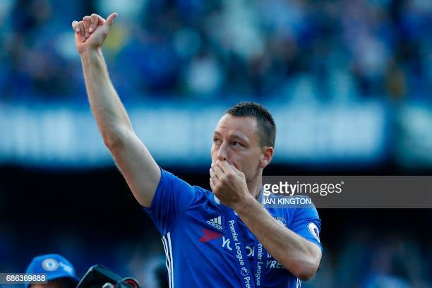 Chelsea's English defender John Terry salutes the crowd at the end of the presentation ceremony for the English Premier League trophy at the end of...