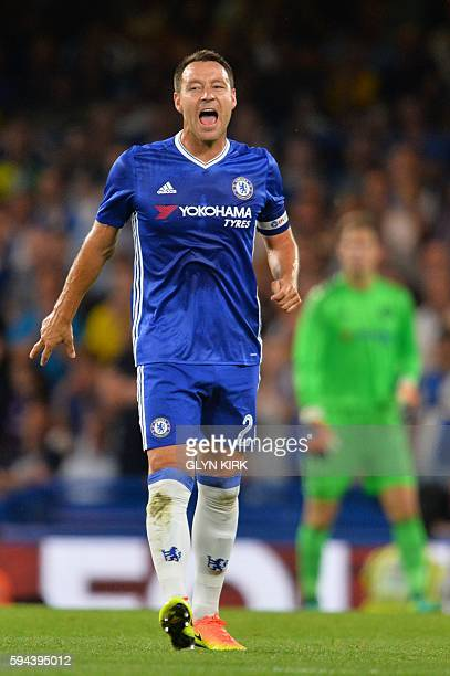 Chelsea's English defender John Terry shouts to his teammates during the English League Cup second round football match between Chelsea and Bristol...