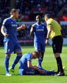 Chelsea's English defender John Terry speaks to referee Phil Dowd before Swansea City's Spanish defender Chico Flores is sent off for a tackle on...