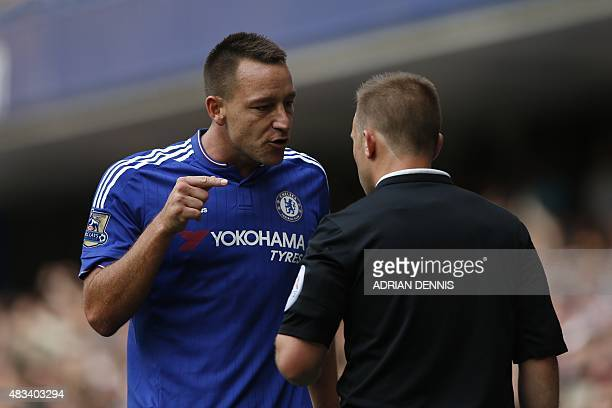 Chelsea's English defender John Terry talks with assistant referee Harry Lennard after Chelsea's Belgian goalkeeper Thibaut Courtois was sent off and...