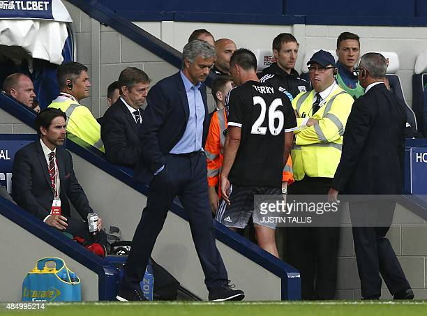 Chelsea's English defender John Terry walks off the pitch after receiving a red card during the English Premier League football match between West...