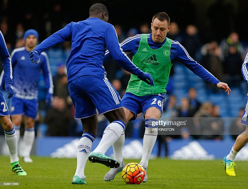 Chelsea's English defender John Terry (R) warms up ahead of the English Premier League football match between Chelsea and Manchester United at Stamford Bridge in London on on February 7, 2016. / AFP / Ian Kington / RESTRICTED TO EDITORIAL USE. No use with unauthorized audio, video, data, fixture lists, club/league logos or 'live' services. Online in-match use limited to 75 images, no video emulation. No use in betting, games or single club/league/player publications. /