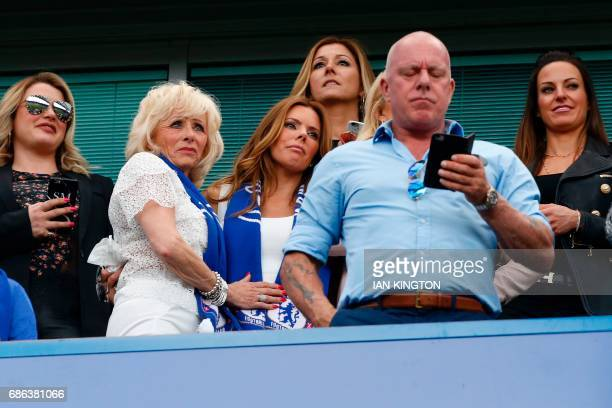 Chelsea's English defender John Terry's wife Toni Terry reacts as her husband speaks at the end of the English Premier League football match between...
