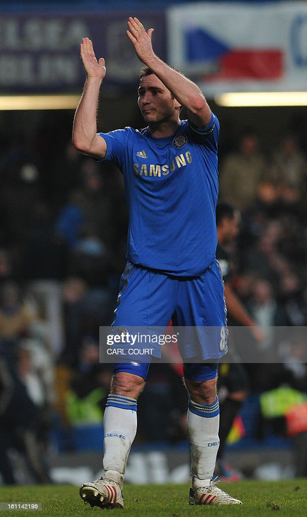 Chelsea's English midfielder Frank Lampard acknowledges the crowd after the English Premier League football match between Chelsea and Wigan Athletic at Stamford Bridge in London on February 9, 2013. Chelsea won 4-1. USE. No use with unauthorized audio, video, data, fixture lists, club/league logos or 'live' services. Online in-match use limited to 45 images, no video emulation. No use in betting, games or single club/league/player publications.