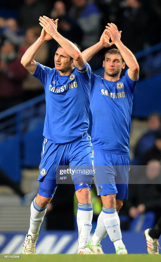 Chelsea's English midfielder Frank Lampard (L) acknowledges the crowd after the English Premier League football match between Chelsea and Wigan Athletic at Stamford Bridge in London on February 9, 2013. Chelsea won 4-1. USE. No use with unauthorized audio, video, data, fixture lists, club/league logos or 'live' services. Online in-match use limited to 45 images, no video emulation. No use in betting, games or single club/league/player publications.
