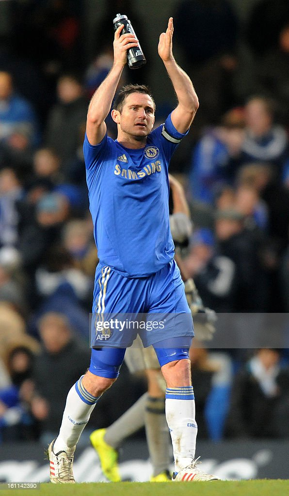 Chelsea's English midfielder Frank Lampard acknowledges the crowd after the English Premier League football match between Chelsea and Wigan Athletic at Stamford Bridge in London on February 9, 2013. Chelsea won 4-1. USE. No use with unauthorised audio, video, data, fixture lists, club/league logos or 'live' services. Online in-match use limited to 45 images, no video emulation. No use in betting, games or single club/league/player publications.