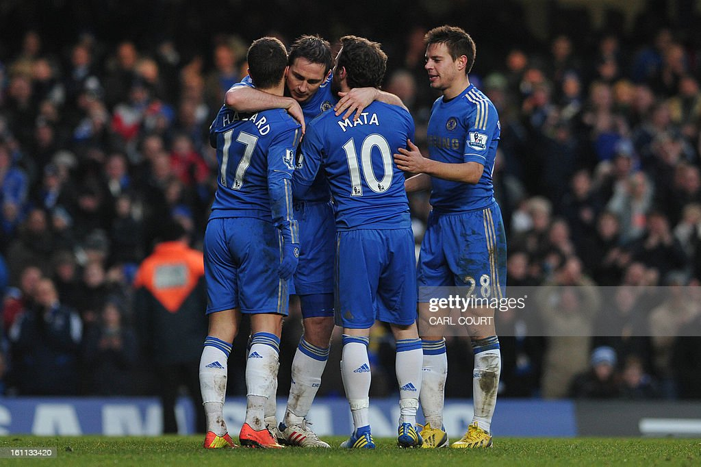 Chelsea's English midfielder Frank Lampard (2L) celebrates after scoring Chelsea's third goal with Chelsea's Belgian midfielder Eden Hazard (L), Chelsea's Spanish striker Juan Mata (2R) and Chelsea's Spanish defender Cesar Azpilicueta (R) during the English Premier League football match between Chelsea and Wigan Athletic at Stamford Bridge in London on February 9, 2013. Chelsea won 4-1. AFP PHOTO / CARL COURT USE. No use with unauthorized audio, video, data, fixture lists, club/league logos or 'live' services. Online in-match use limited to 45 images, no video emulation. No use in betting, games or single club/league/player publications.