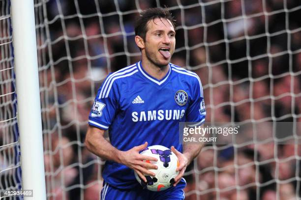 Chelsea's English midfielder Frank Lampard celebrates after scoring Chelsea's second goal from the rebound after Stoke City's Bosnian goalkeeper...