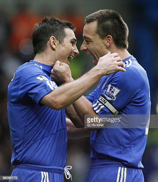 Chelsea's English midfielder Frank Lampard celebrates scoring a goal with captain John Terry during the English Premier League football match between...
