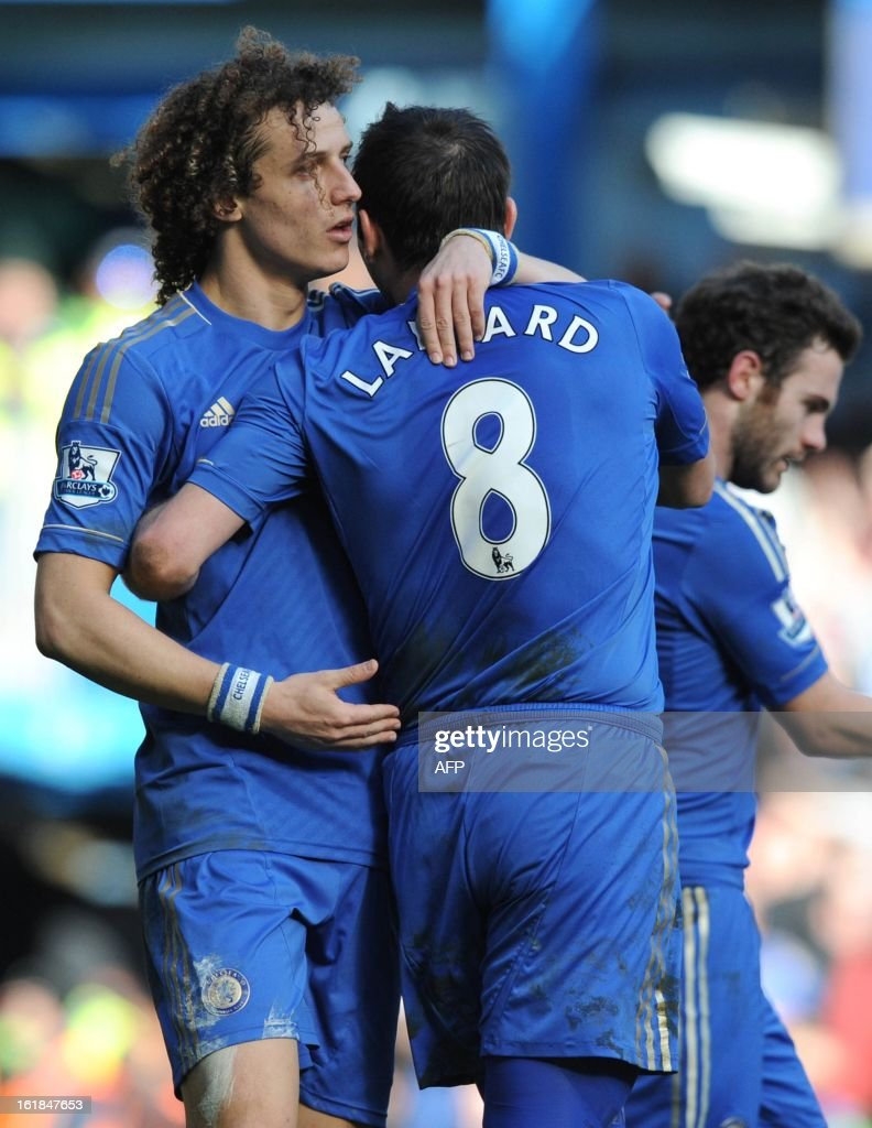 """Chelsea's English midfielder Frank Lampard (R ) celebrates with Brazilian teammate David Luis after scoring a goal during the fourth round replay English FA Cup football match between Chelsea and Brentford at Stamford Bridge in London on February 17, 2013. Chelsea won 4-0. AFP PHOTO/OLLY GREENWOOD - RESTRICTED TO EDITORIAL USE. No use with unauthorized audio, video, data, fixture lists, club/league logos or """"live"""" services. Online in-match use limited to 45 images, no video emulation. No use in betting, games or single club/league/player publications."""