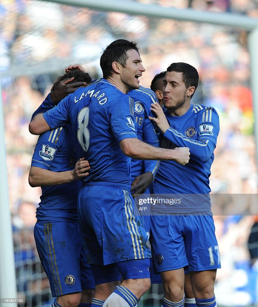 """Chelsea's English midfielder Frank Lampard (L ) celebrates with teammates scoring a goal during the fourth round replay English FA Cup football match between Chelsea and Brentford at Stamford Bridge in London on February 17, 2013. AFP PHOTO/OLLY GREENWOOD - RESTRICTED TO EDITORIAL USE. No use with unauthorized audio, video, data, fixture lists, club/league logos or """"live"""" services. Online in-match use limited to 45 images, no video emulation. No use in betting, games or single club/league/player publications."""