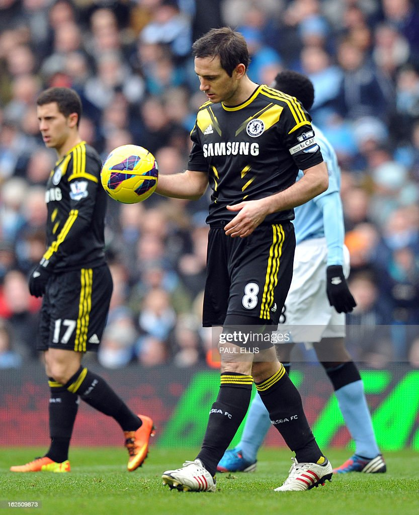 "Chelsea's English midfielder Frank Lampard holds the ball during the English Premier League football match between Manchester City and Chelsea at the Etihad Stadium in Manchester, northwest England, on February 24, 2013. USE. No use with unauthorized audio, video, data, fixture lists, club/league logos or ""live"" services. Online in-match use limited to 45 images, no video emulation. No use in betting, games or single club/league/player publications."