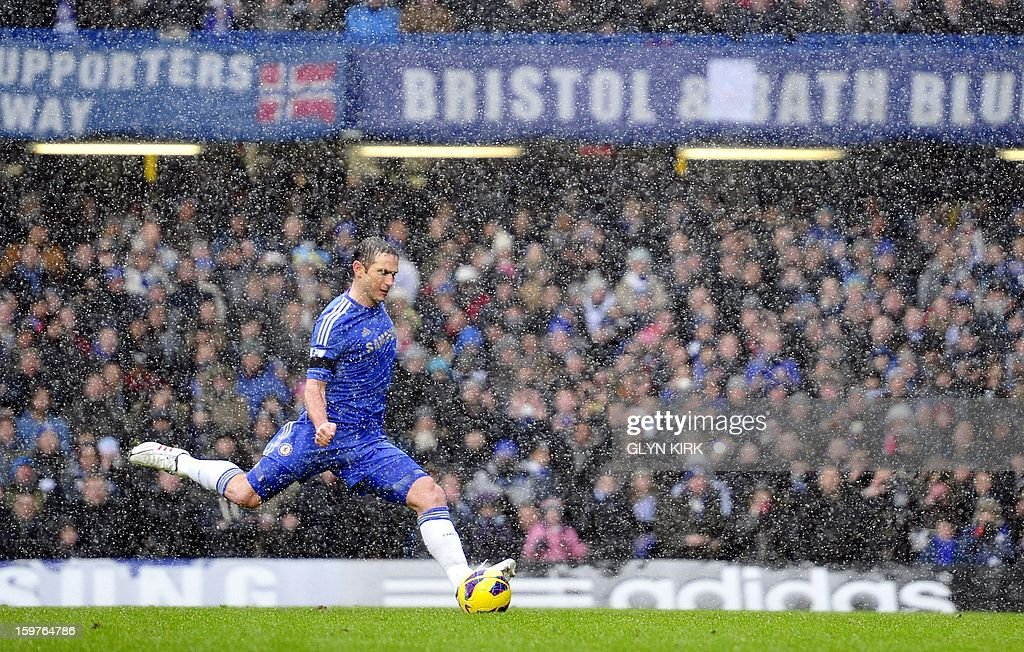 "Chelsea's English midfielder Frank Lampard scores their second goal during their English Premier League football match against Arsenal at Stamford Bridge in London, England on January 20, 2013. AFP PHOTO/Glyn KIRK - RESTRICTED TO EDITORIAL USE. No use with unauthorized audio, video, data, fixture lists, club/league logos or ""live"" services. Online in-match use limited to 45 images, no video emulation. No use in betting, games or single club/league/player publications."