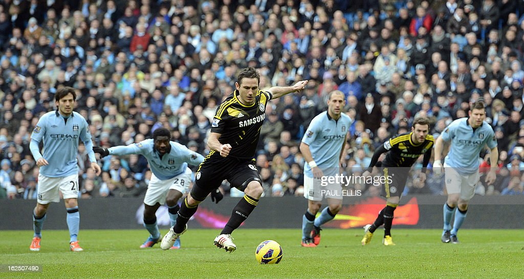 "Chelsea's English midfielder Frank Lampard (C) takes his penalty, saved by Manchester City's English goalkeeper Joe Hart (not pictured) during the English Premier League football match between Manchester City and Chelsea at the Etihad Stadium in Manchester, northwest England, on February 24, 2013. USE. No use with unauthorized audio, video, data, fixture lists, club/league logos or ""live"" services. Online in-match use limited to 45 images, no video emulation. No use in betting, games or single club/league/player publications."