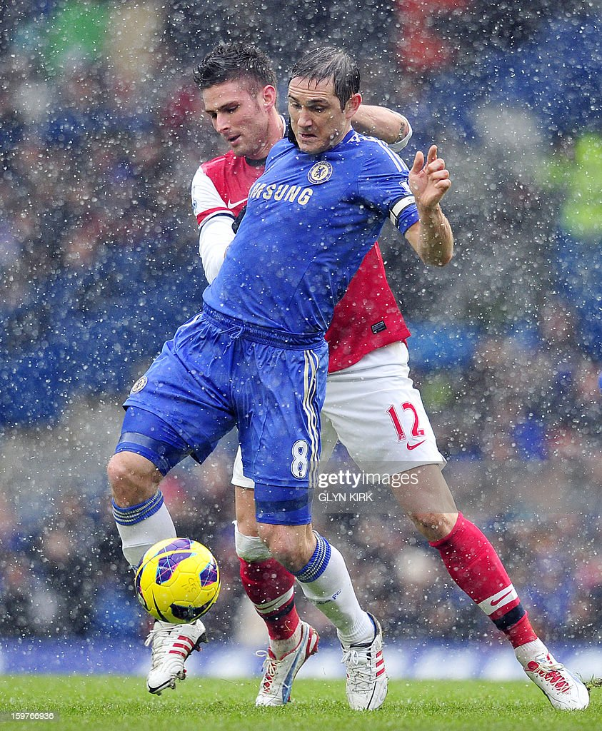 "Chelsea's English midfielder Frank Lampard (R) vies with Arsenal's French striker Olivier Giroud (L) during their English Premier League football match at Stamford Bridge in London on January 20, 2013. USE. No use with unauthorized audio, video, data, fixture lists, club/league logos or ""live"" services. Online in-match use limited to 45 images, no video emulation. No use in betting, games or single club/league/player publications."