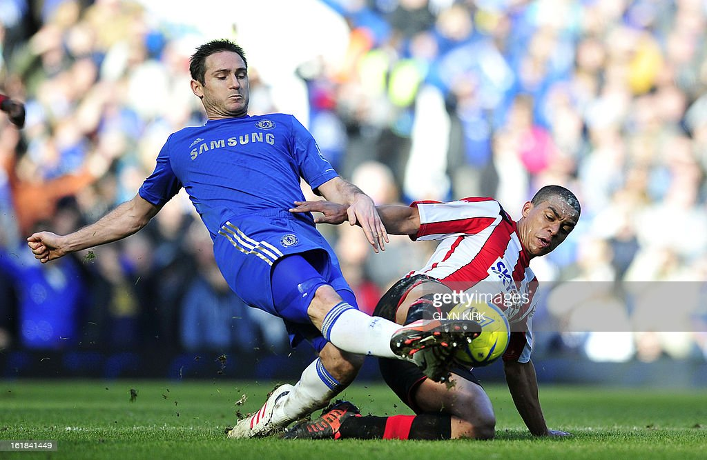 """Chelsea's English midfielder Frank Lampard (L) vies with Brentford's English midfielder Tom Adeyemi (R) during the English FA Cup fourth round replay football match between Chelsea and Brentford at Stamford Bridge in London on February 17, 2013. USE. No use with unauthorized audio, video, data, fixture lists, club/league logos or """"live"""" services. Online in-match use limited to 45 images, no video emulation. No use in betting, games or single club/league/player publications."""