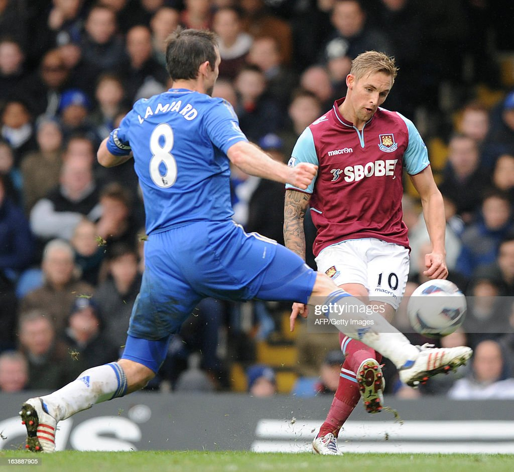 """Chelsea's English midfielder Frank Lampard (L) vies with West Ham United's Welsh midfielder Jack Collison (R) during the English Premier League football match between Chelsea and West Ham United at Stamford Bridge in London on March 17, 2013. USE. No use with unauthorized audio, video, data, fixture lists, club/league logos or """"live"""" services. Online in-match use limited to 45 images, no video emulation. No use in betting, games or single club/league/player publications."""