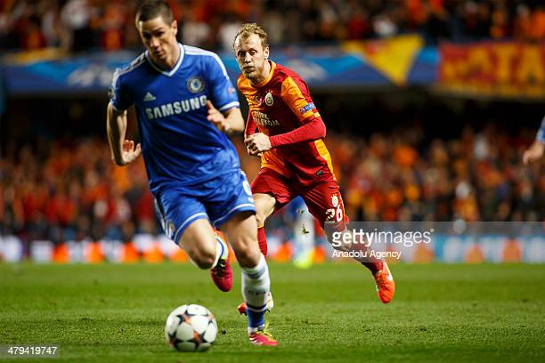 Chelseas Fernando Torres vies with Galatasarays Semih Kaya during the UEFA Champions League Round of 16 second leg soccer match between Chelsea and...