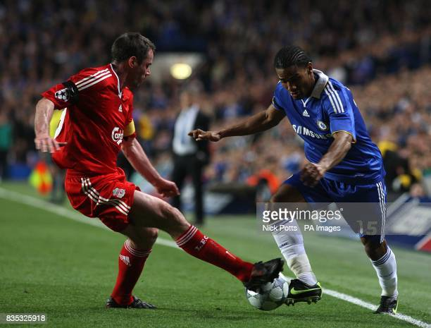 Chelsea's Florent Malouda and Liverpool's Jamie Carragher battle for the ball