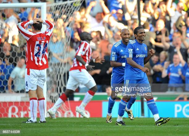 Chelsea's Florent Malouda celebrates scoring his sides second goal of the game with teammate Nicolas Anelka