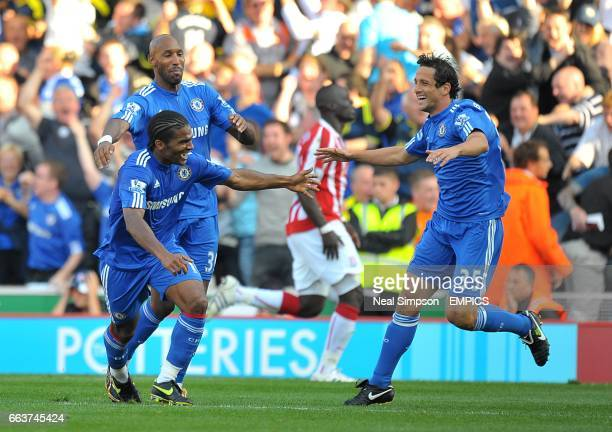 Chelsea's Florent Malouda celebrates scoring his sides second goal of the game with teammates Nicolas Anelka and Juliano Belletti