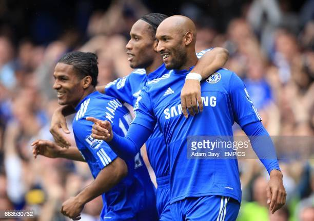 Chelsea's Florent Malouda celebrates scoring the opening goal of the game with Didier Drogba and Nicolas Anelka