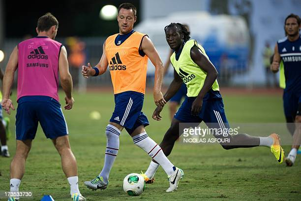 Chelsea's football player John Terry and Romelu Lukaku participate in a training session at the Rajamangala stadium in Bangkok on July 16 2013 Jose...