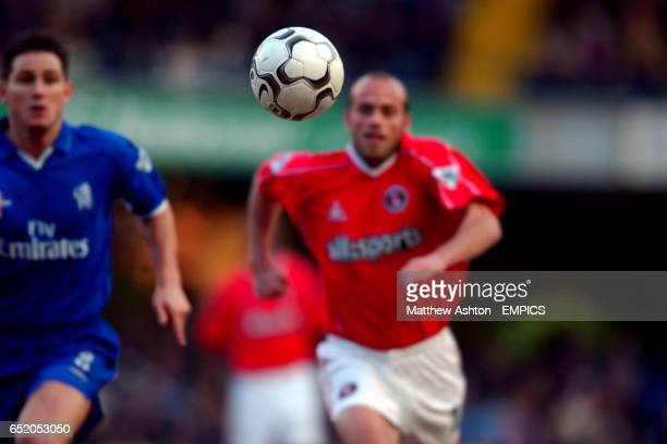 Chelsea's Frank Lampard and Charlton Athletic's Claus Jensen focus their attention on chasing the loose ball