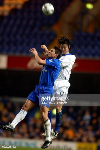Chelsea's Frank Lampard and Everton's Li Tie jump for the ball
