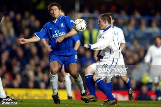 Chelsea's Frank Lampard and Everton's Wayne Rooney battle for the ball