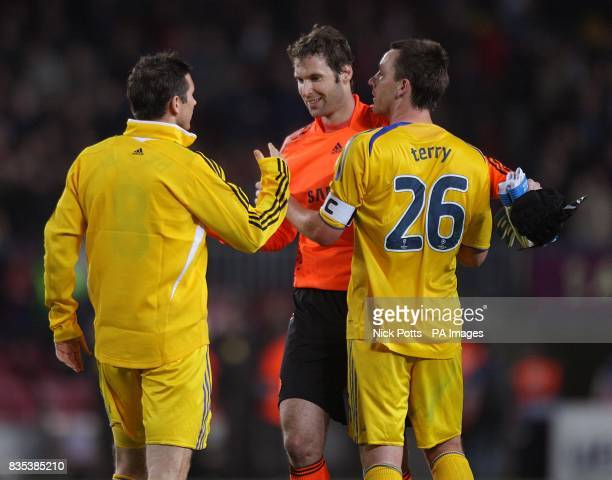 Chelsea's Frank Lampard and John Terry congratulate their team mate Petr Cech on his performance after the final whistle