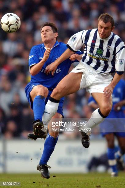 Chelsea's Frank Lampard and West Bromwich Albion's Ronnie Wallwork battle for ball