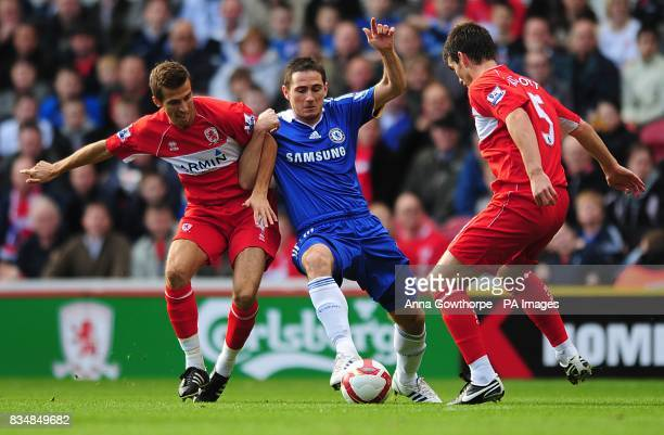 Chelsea's Frank Lampard battles Middlesbrough's Chris Riggott and Gary O'Neil for the ball