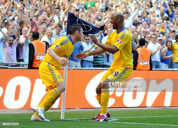 Chelsea's Frank Lampard celebrates scoring his sides second goal of the game with teammate Nicolas Anelka