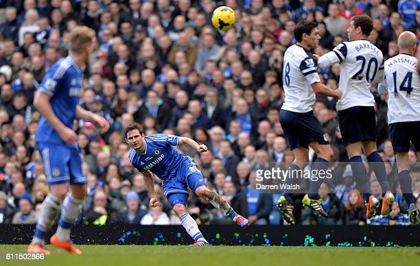 Chelsea's Frank Lampard crosses the ball to assist the winning goal by John Terry