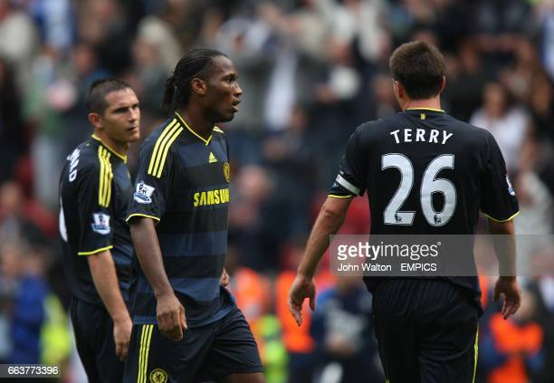 Chelsea's Frank Lampard Didier Drogba and John Terry stand dejected after the final whistle