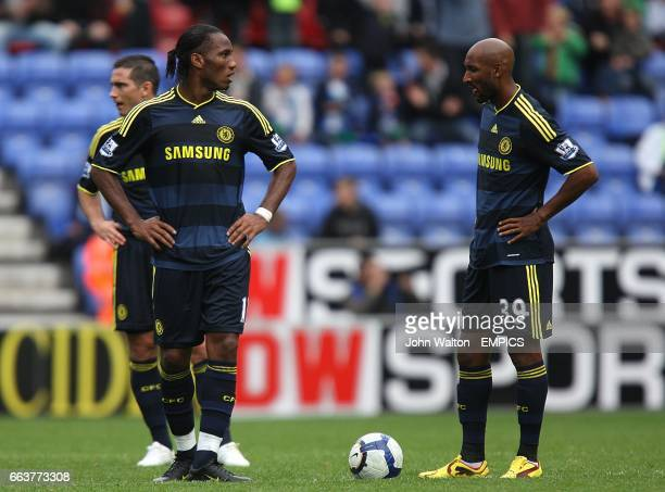Chelsea's Frank Lampard Didier Drogba and Nicolas Anelka stand dejected after Wigan score their third goal