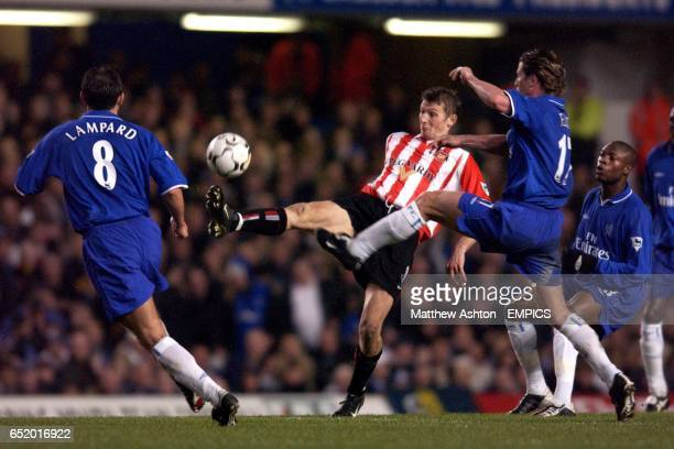 Chelsea's Frank Lampard Emmanuel Petit and William Gallas close in on Tore Andre Flo of Sunderland