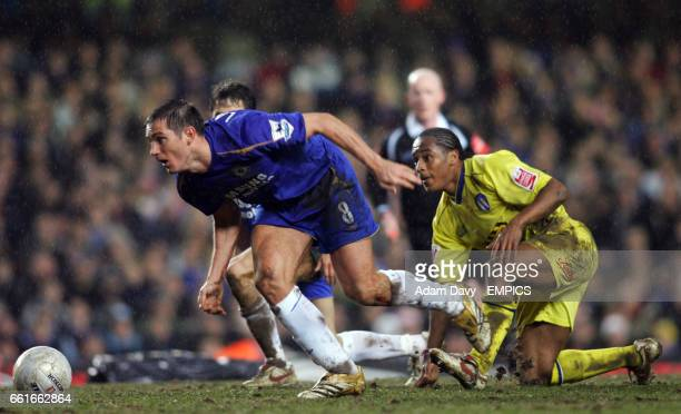 Chelsea's Frank Lampard gets away from Colchester United's Chris Iwelumo